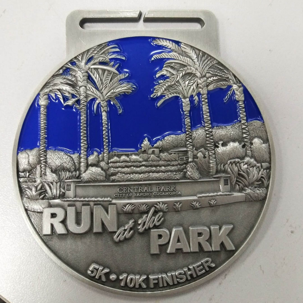 Round Custom 5k Finisher Medal with Palm Trees in Park